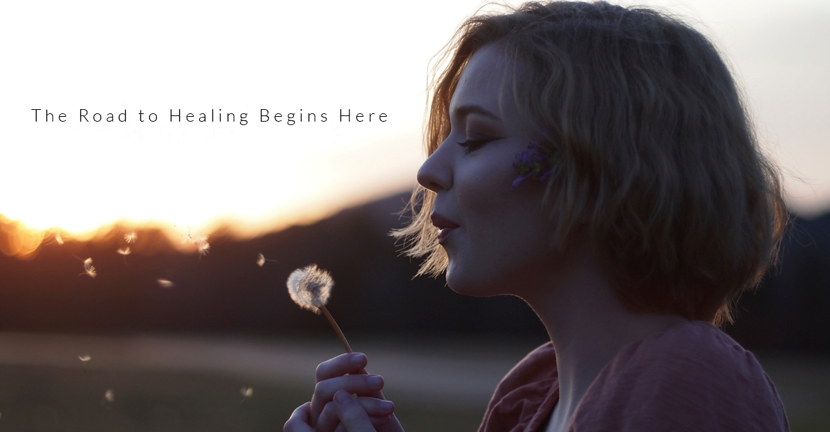 Woman blowing a dandelion | Support For Pregnancy and Infant Loss | Child Loss Grief Counseling | Pregnancy After Loss Support | Evolve Counseling, LLC | Centennial, CO