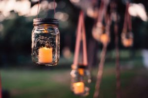 Lit candle in a mason jar | Grief Counseling | Pregnancy and infant loss | Evolve Counseling | Centennial CO 80112