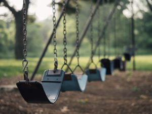 Empty swings on a playground | Ways child loss is different than other losses | Child Loss Grief Counseling | Infant and Pregnancy Loss | Evolve Counseling | Centennial CO 80112