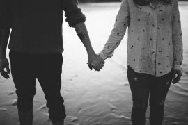 Man and woman holding hands. Child loss grief | Pregnancy Loss | Infant Loss | Grief Counseling